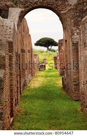 Ancient Roman Arch Walls Street Ostia Antica Ruins Rome Italy Excavation of Ostia, ancient Roman port, next to airport.  Was port for Rome until 5th Century AD. - stock photo