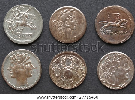 Ancient Roman coins on a black background - stock photo
