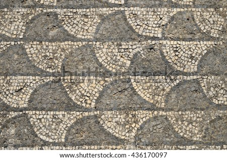 Ancient Roman mosaic with wave patterns, located at Milreu Historical Site, Algarve, Portugal - stock photo
