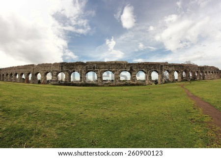 Ancient Roman ruins at the Parco degli Acquedotti, public park in Rome, Italy - stock photo