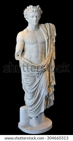 Ancient Roman sculpture of Julius Caesar, wearing the oak leaf cluster, and toga thrown over his hips. Isolated against a black background - stock photo