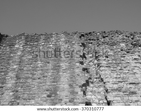 Ancient Roman wall ruins in London, UK in black and white - stock photo