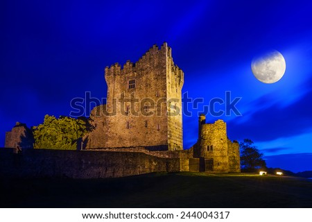 Ancient Ross castle at night with full moon, Ireland - stock photo