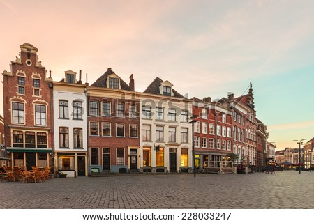 Ancient row of houses in the historic Dutch city of Zutphen during sunset - stock photo