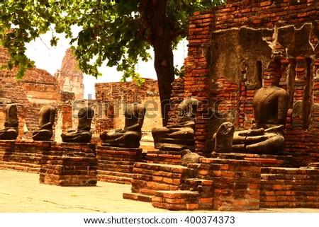 Ancient Ruin Stone Buddha Statue, Headless of Buddha image in Ayuthaya Thailand - stock photo