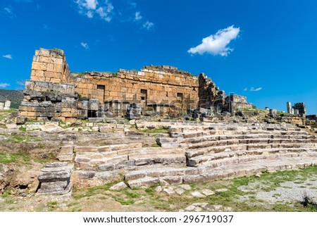 Ancient ruins in Hierapolis, Pamukkale, Turkey. The site is a UNESCO World Heritage site - stock photo