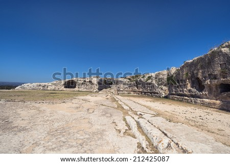 Ancient ruins of Greek Theater in Syracuse, Sicily - stock photo