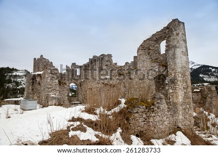 Ancient ruins of mountain castle in winter time, Austria - stock photo