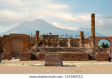 Ancient ruins of Pompei with volcano Vesuvius at back during sunset, Italy - stock photo