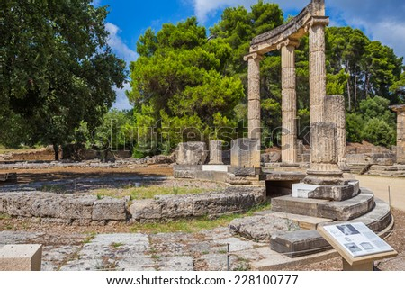 ancient ruins of the Philippeion in Ancient Olympia, birthplace of the Olympic games - UNESCO world heritage site  - stock photo