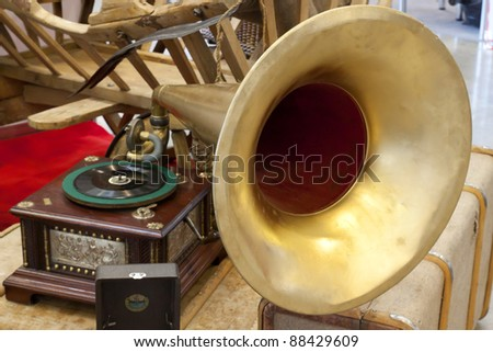Ancient Russian use subjects. A cart, a record player, suitcases. Antiques - stock photo