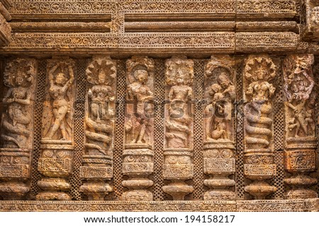 Ancient sandstone carvings on the walls of the ancient sun temple at Konark, India. - stock photo
