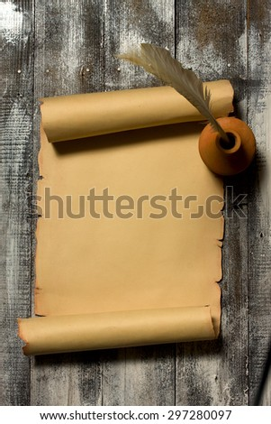 Ancient scroll rolled in wooden Background with Quill Pen Top View - stock photo