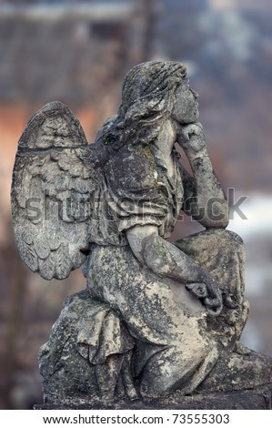 Ancient sculpture of an angel with wings - stock photo