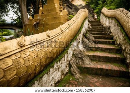 Ancient stairs at Luang Prabang - stock photo