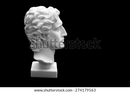 Ancient statue of Alexander the Great isolated on a black background  - stock photo