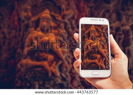 Ancient statues in the temple. The photo is taken with telephone - stock photo