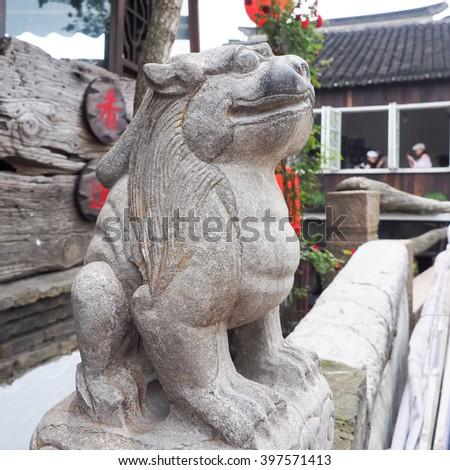 ancient stone lion on the bridge - stock photo