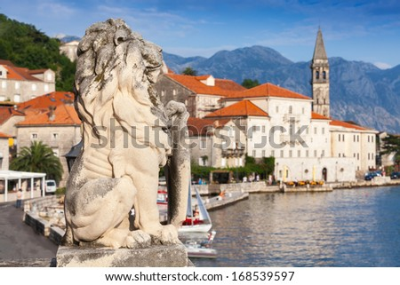 Ancient stone lion statue in Perast town, Bay of Kotor, Montenegro - stock photo