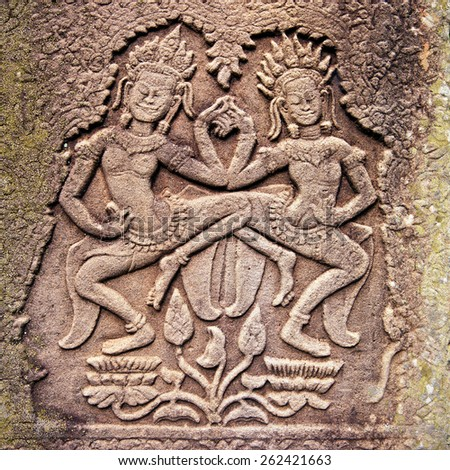 Ancient stone relief in Angkor Wat, Cambodia - stock photo