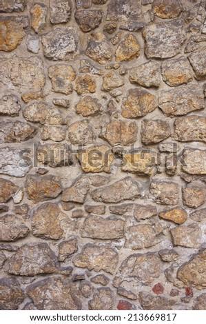 Ancient stone wall texture - stock photo