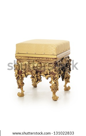 Ancient stool in a gold ornament isolated - stock photo
