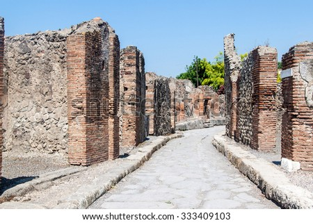 Ancient street at ruins of ancient city Pompeii, destroyed by volcanic eruption of Vesuvio mountain, Italy - stock photo