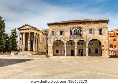 Ancient Temple Of Augustus With Corinthian Columns And Communal Palace - Pula, Istria, Croatia - stock photo