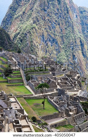 ancient terraces and ancient houses to Machu Picchu - stock photo