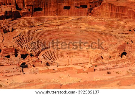 Ancient theater in Petra (Rose City), Jordan. The city of Petra was lost for over 1000 years. Now one of the Seven Wonders of the Word - stock photo