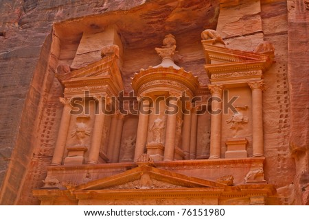 Ancient tombs, temples and dwellings carved into bare rock in Petra, Jordan - stock photo