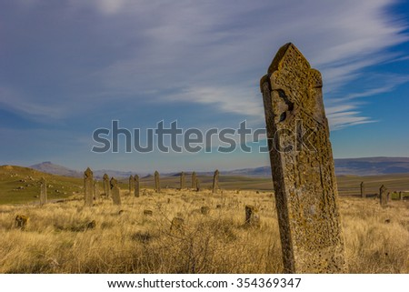 Ancient tombstone in muslim cemetery near Qobustan, Azerbaijan - stock photo