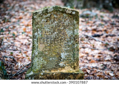 Ancient tombstone on old jewish cemetery - stock photo