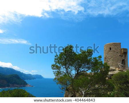 ancient tower in the tramuntana mountains, majorca, with a view to the mediterranean sea - stock photo
