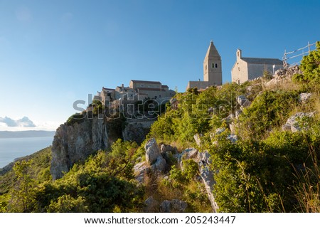 Ancient town of Lubenice and cliff in Cres - Croatia - stock photo
