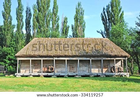Ancient traditional ukrainian rural wooden barn, Kiev, Ukraine - stock photo