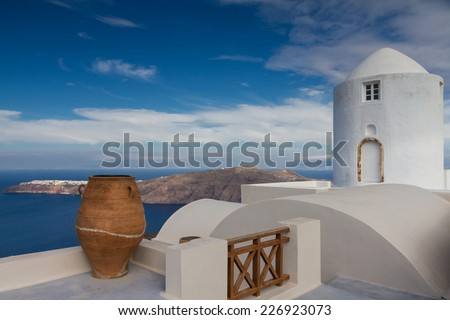 Ancient vase and windmill at Santorini, Greece - stock photo