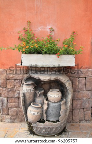 ancient vase with flowers in pot wooden - stock photo