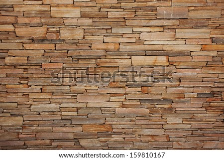 Ancient wall built of solid flat stones - stock photo