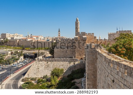Ancient walls and old Tower of David under blue sky in Jerusalem, Israel. - stock photo
