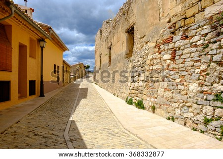 Ancient walls in Morella street, the province of Castellon, Spain. - stock photo