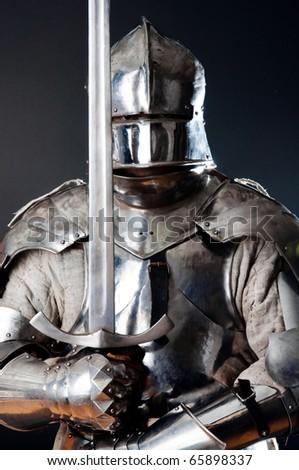 Ancient warrior in iron helmet - stock photo