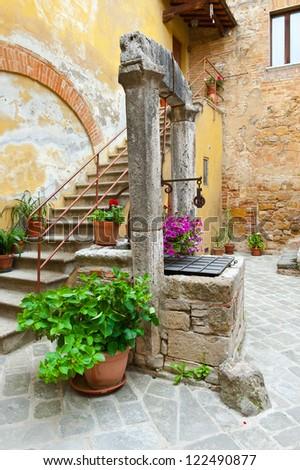 Ancient Well in Courtyard, Italian City of Cetona - stock photo