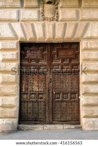 Ancient wooden entrance door of Spain - stock photo