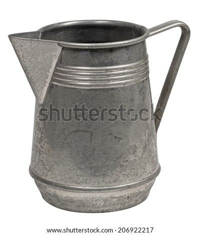 Ancient worn out milk jug isolated on white - stock photo