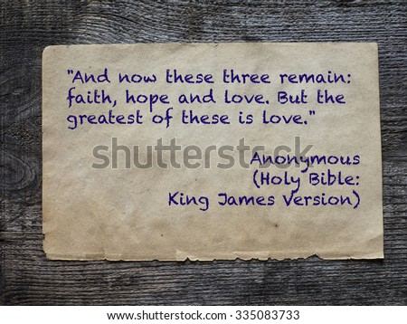 And now these three remain: faith, hope and love. But the greatest of these is love. Quote from Holy Bible: King James Version - stock photo