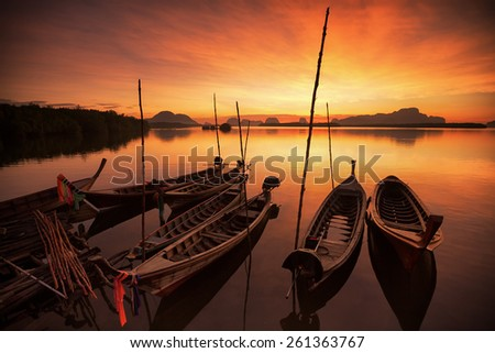 andaman long tailed boat southern of thailand floating on clear sea water with sun shine in phuket - stock photo