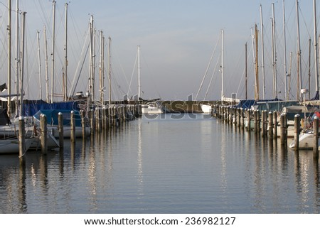 ANDIJK , THE NETHERLANDS - 12 JANUARY : Polyester Sailboats in the marina on january 12,2014 in Andijk, The Netherlands.  - stock photo