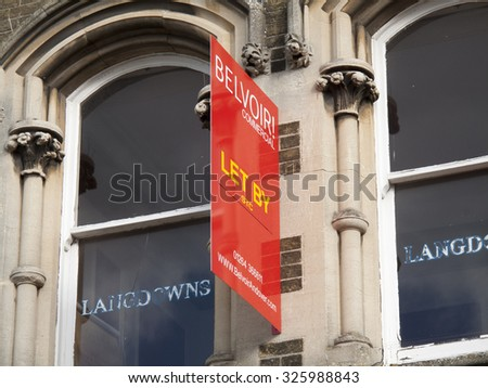 Andover, High Street, Hampshire, England - October 10, 2015: Commercial vacant offices let by sign over retail units - stock photo