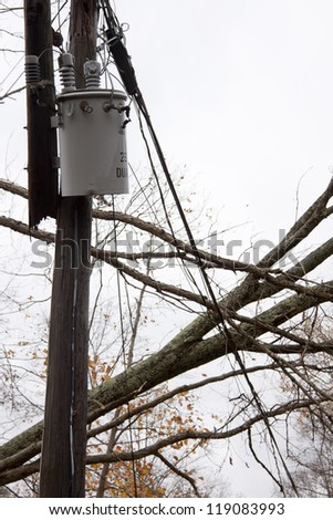 ANDOVER, NJ - OCT 30: A transformer on a pole and a tree laying across power lines over a road after Hurricane Sandy moved across the northeast in Andover, New Jersey on October 30, 2012. - stock photo